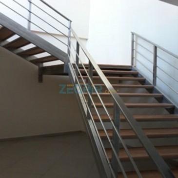 Rampe escalier escargot bois-inox